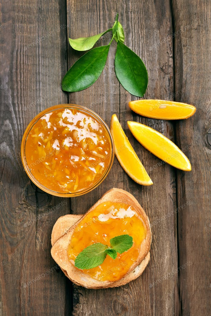 Bread and orange jam, top view