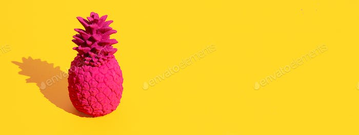 Pink pineapple on yellow background. Minimal. Still life. Copy space