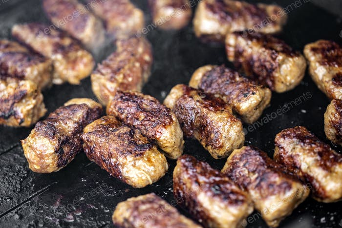 Grilled meat rolls called Mici or Mititei, traditional Romanian food