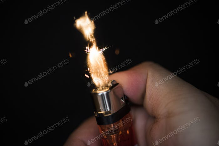 Macro shot of hand holding lighter