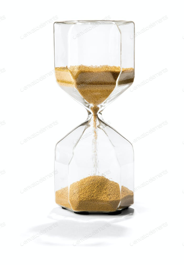 Sand running through an hourglass with shadow