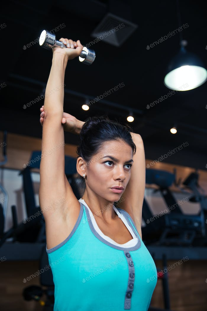 Woman workout with dumbbell