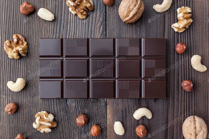 Delicious dark chocolate on wooden background