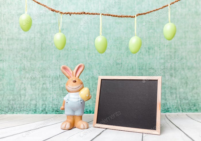 Easter holiday bunny and an empty blackboard