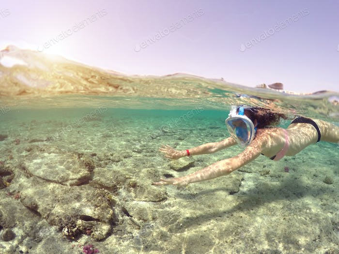 Woman snorkeling close to coral reef, Red Sea, Egypt