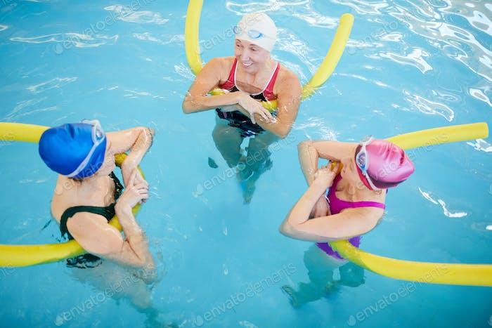 Three Women Relaxing in Pool