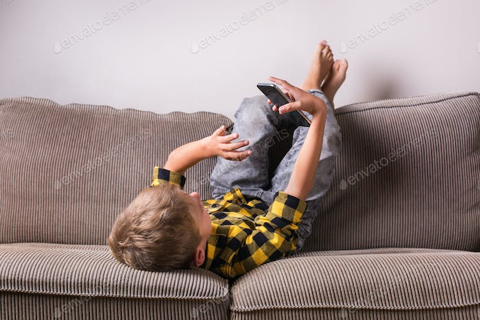 Boy making video call. Social distancing, stay at home, lockdown.