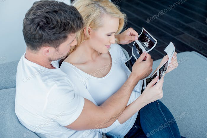 Sweet Couple Looking Ultrasound Result Together