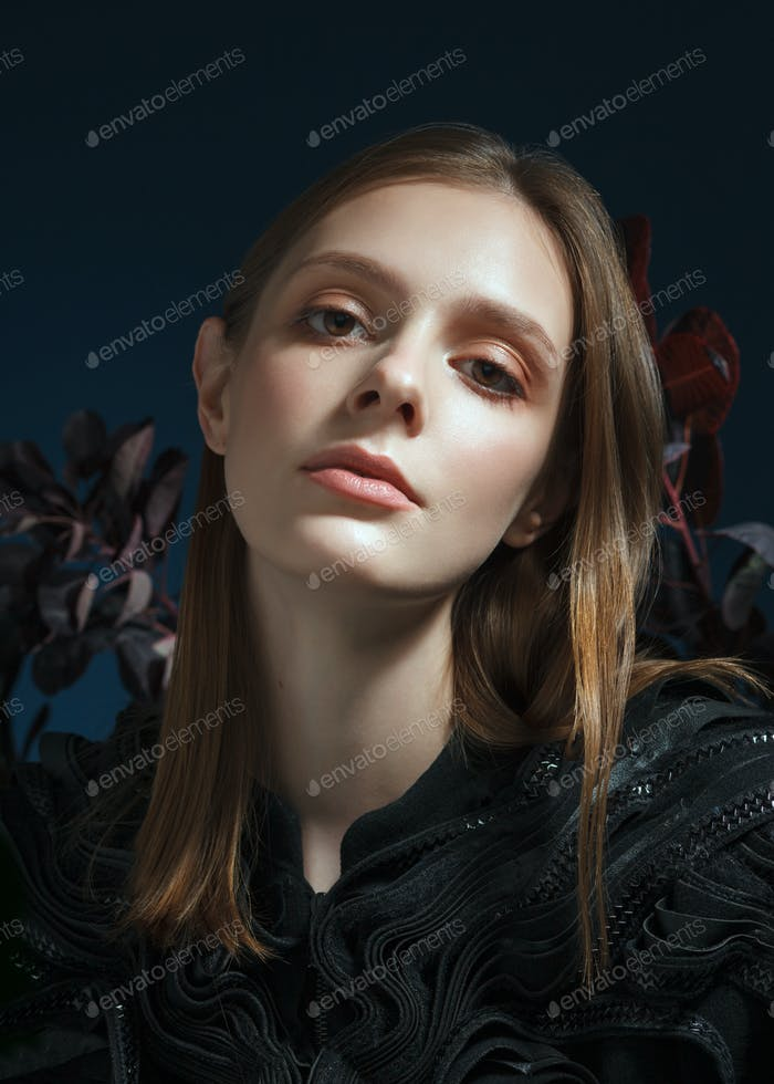 portrait of cuacasian pale young woman over dark background