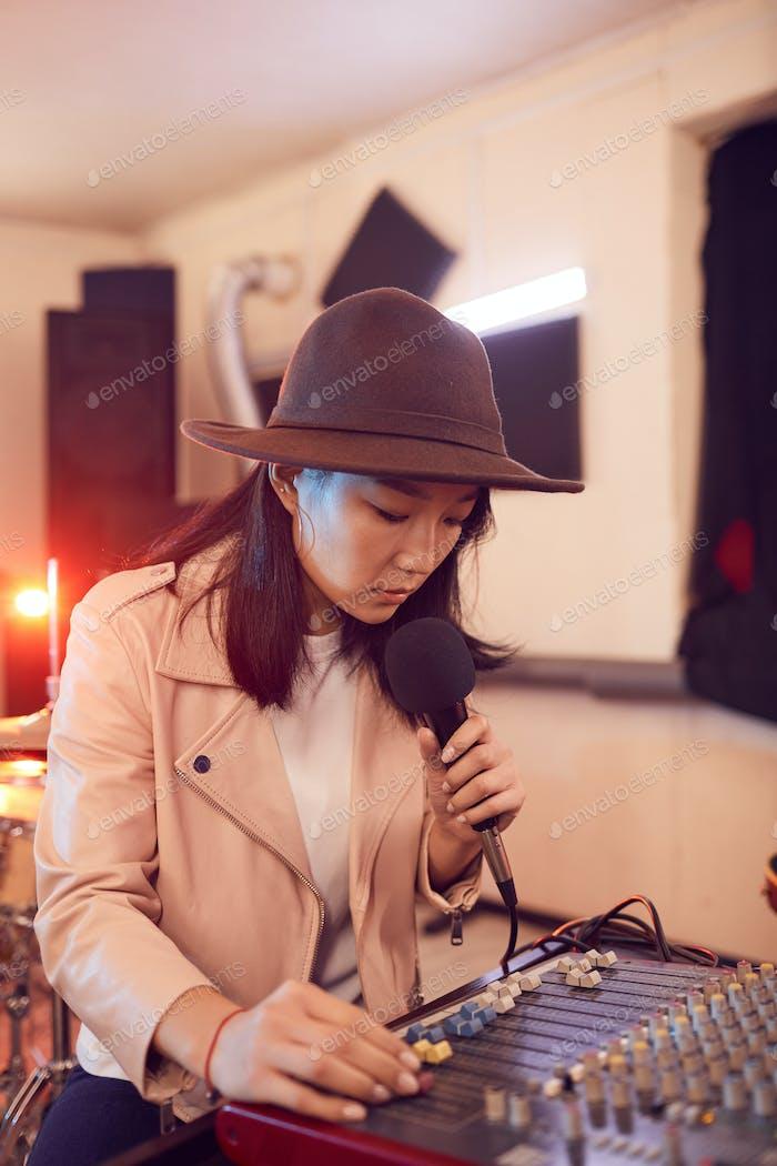 Young Asian Woman Writing Music