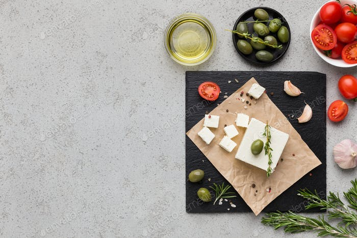 Block of butter and spices on concrete background
