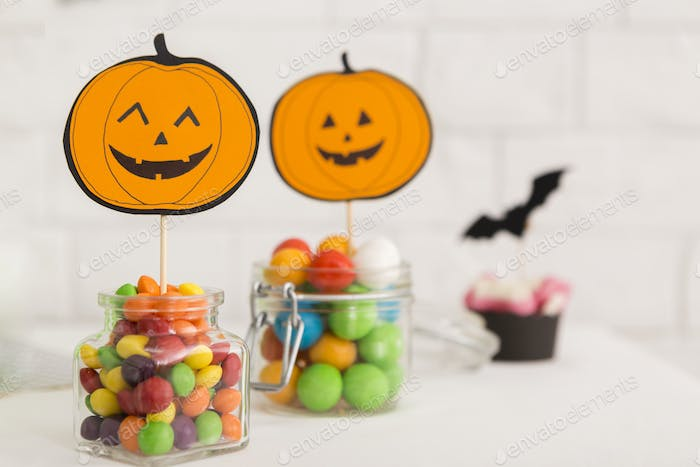 Halloween candies with paper pumpkins for entertainment