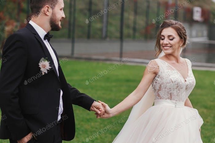 Sensual wedding couple smiling.
