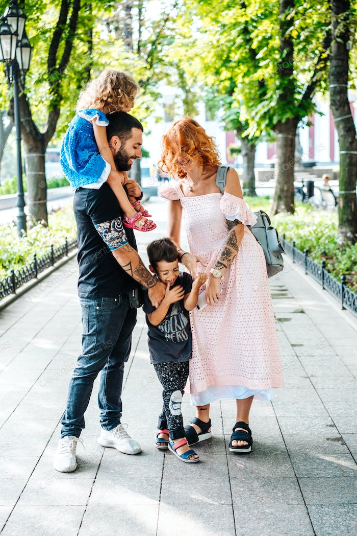 Happy beautiful family walking in the park