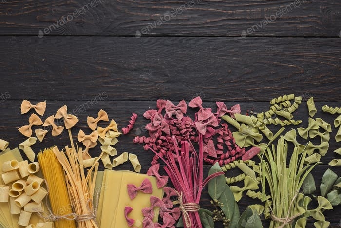 Various types of handmade pasta on black background