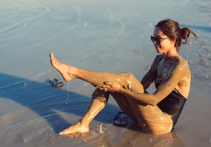 A young woman enjoying the natural mineral mud