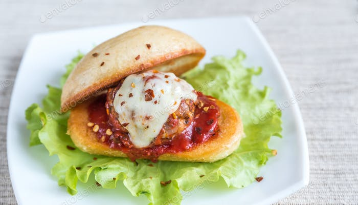 Sandwich with meatball in tomato sauce and mozzarella