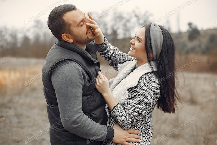 Beautiful couple spend time in a spring field