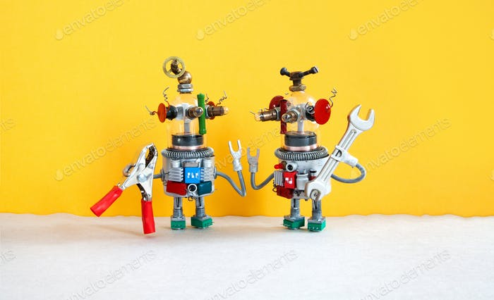 Two comical electrician robots are ready for maintenance.