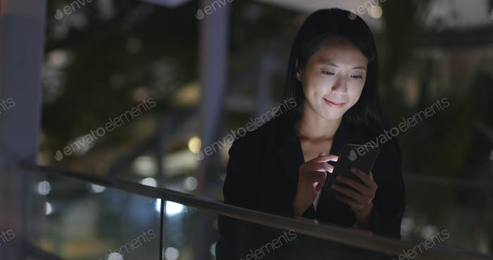 Businesswoman browse on internet with cellphone