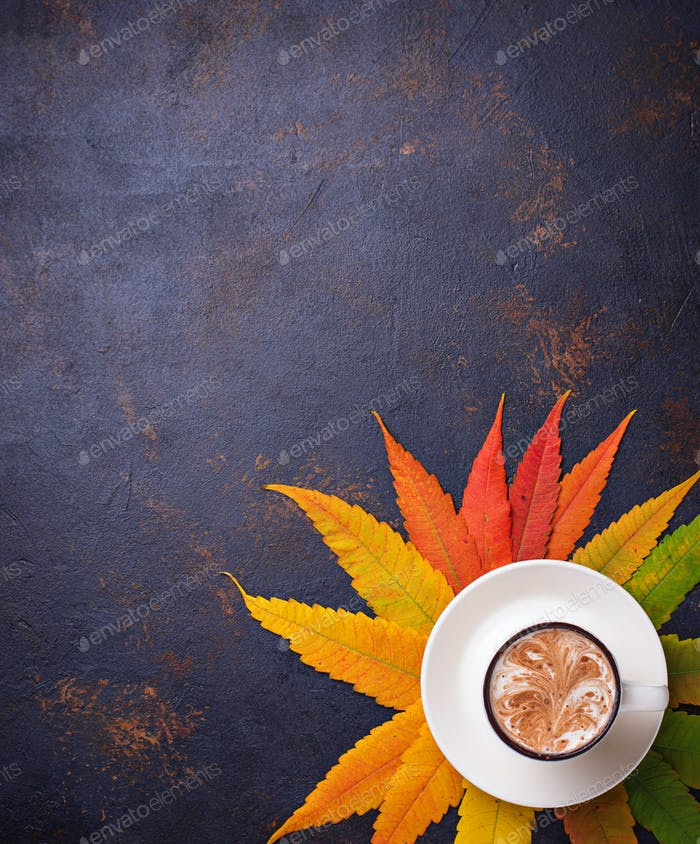 Autumn background with leaves and cup of coffee.