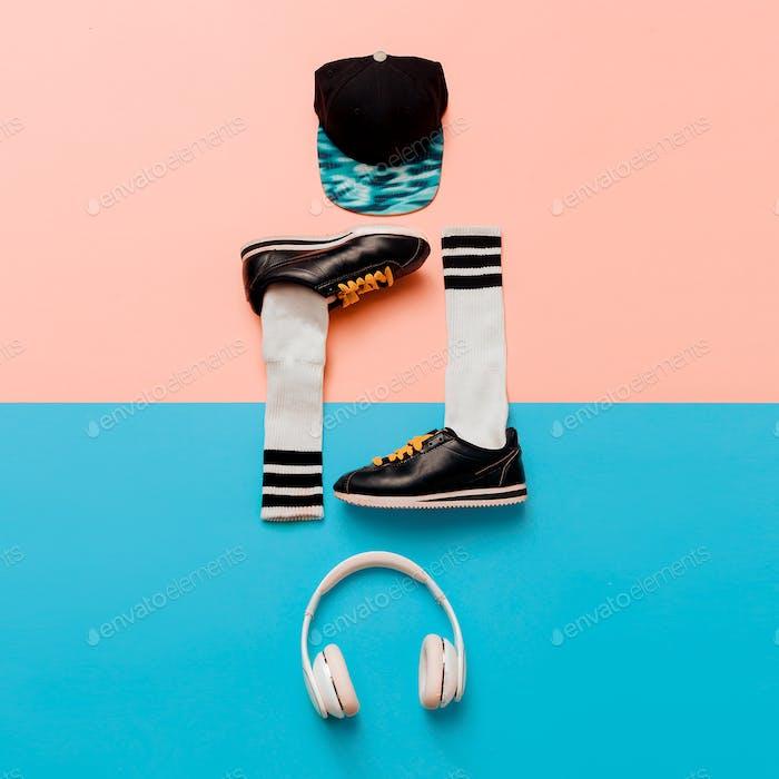 Minimal fashion creative art. Stylish sneakers and socks. Cap. H