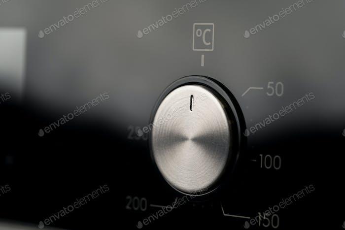 Modern oven mode control button close up