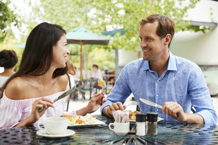 Portrait Of Couple Enjoying Meal At Outdoor CafŽ Together