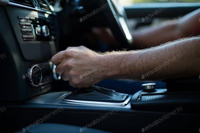 Close up of man driving car