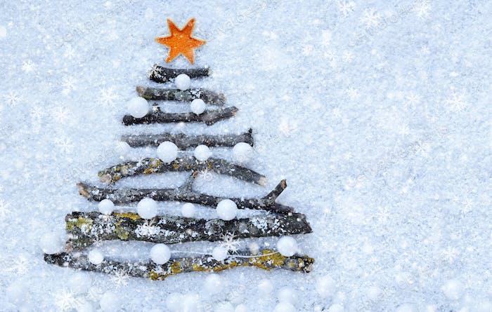 Greeting card. Decorative Christmas tree on the snow. Christmas