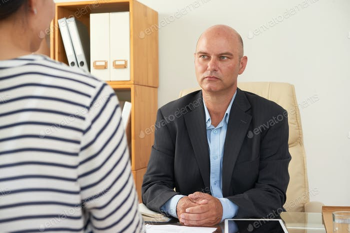 Consultant working with client at office