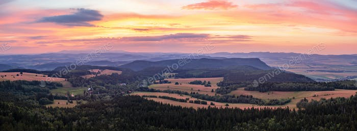 Sunset panorama, inspiring landscape, green forest and mountains