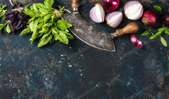 Healthy food cooking background over dark blue painted plywood texture