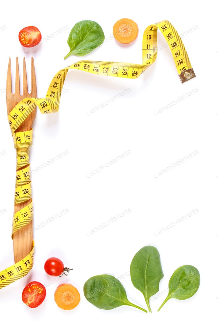Frame of fork wrapped in centimeter and fresh vegetables
