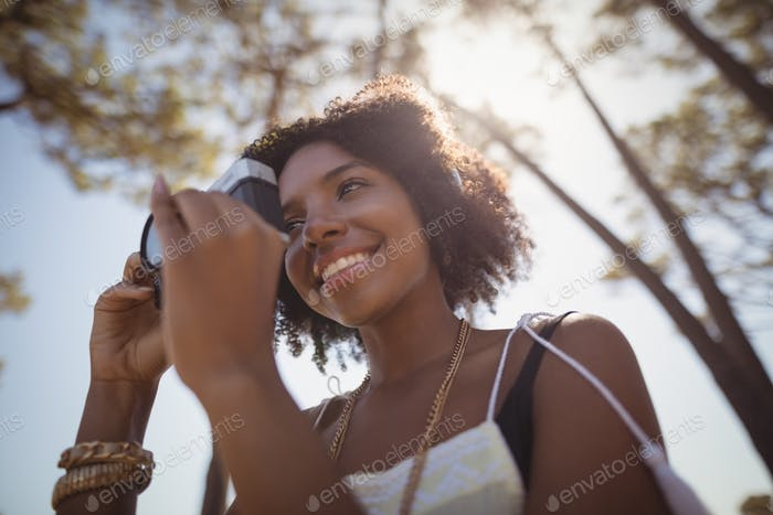 Low angle view of woman photographing