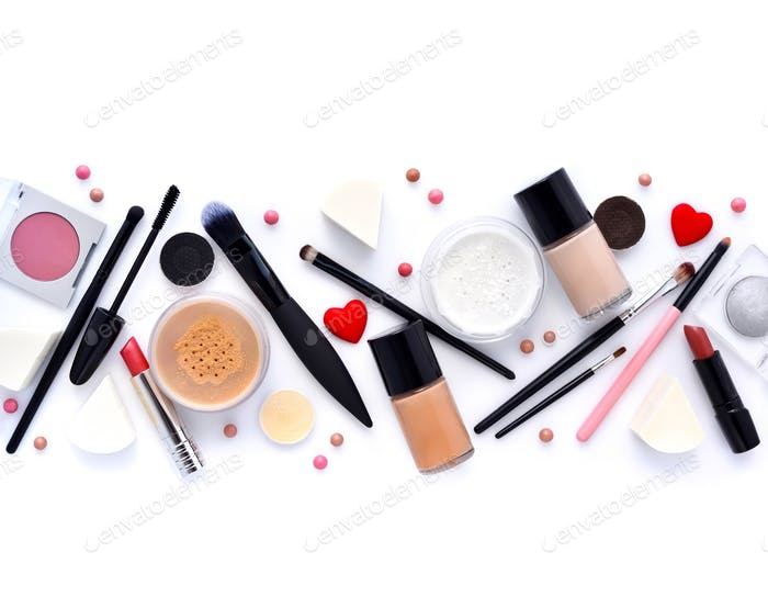 Makeup brush and decorative cosmetics on a white background. Top