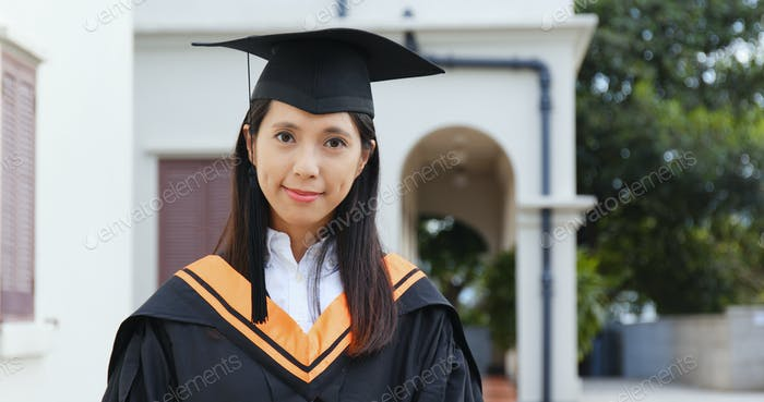 Woman wear graduation gown in campus