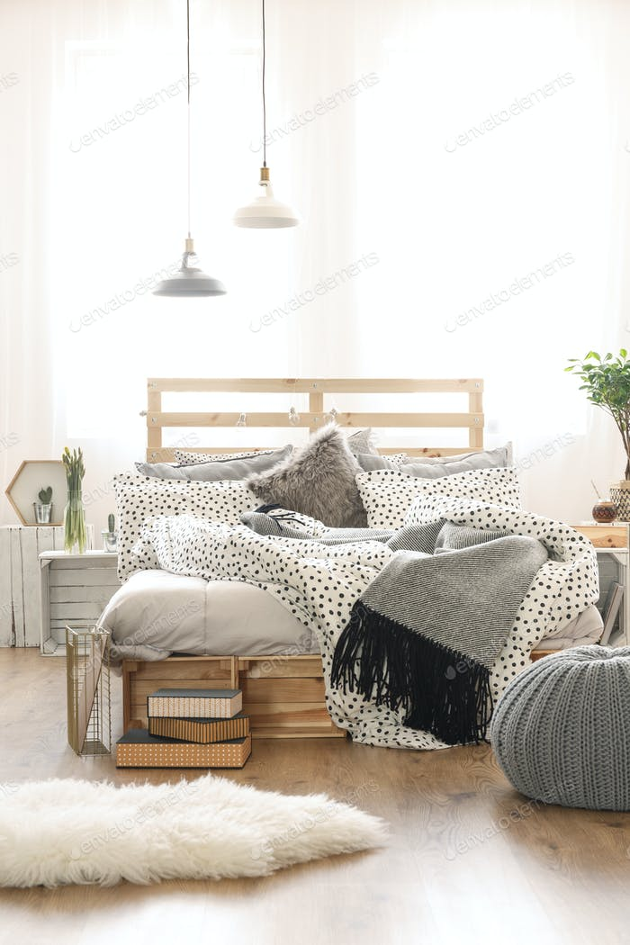 Bed in stylish bedroom