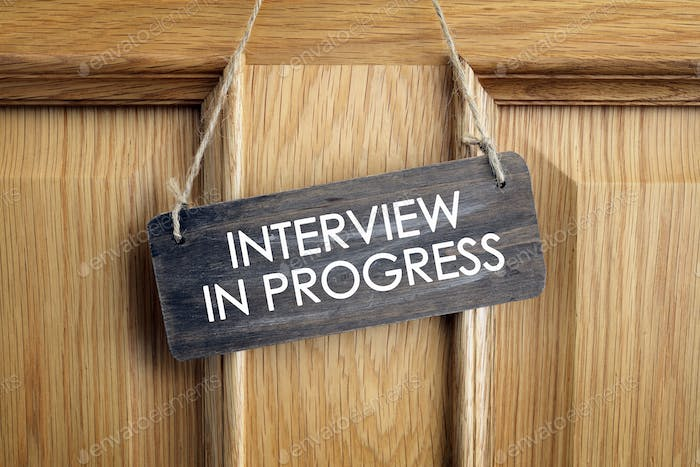 Interview in progress sign on office door