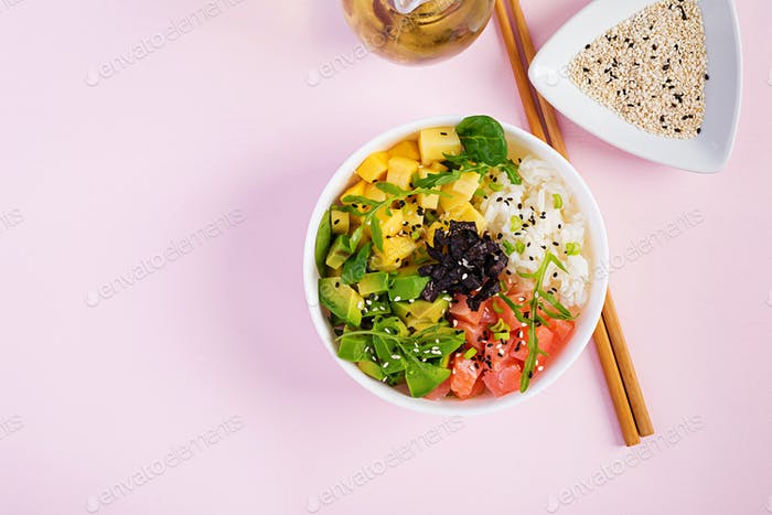 Buddha bowl with rice, mango, avocado and salmon. Healthy food concept. Top view. Flat lay