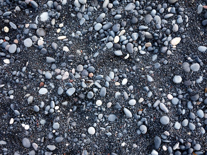 Gray pebbles as a background in the Iceland sea shore.