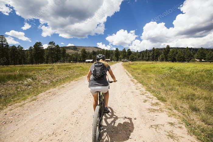 adult woman on mountain bike
