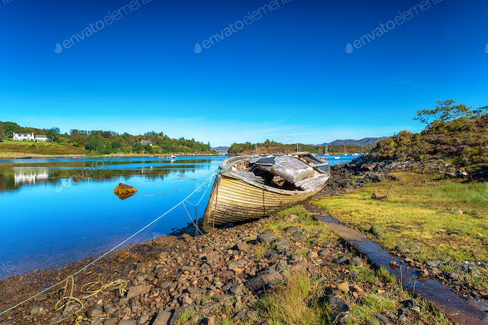 An old fishing boat on the shore of Gair Loch at Badachro