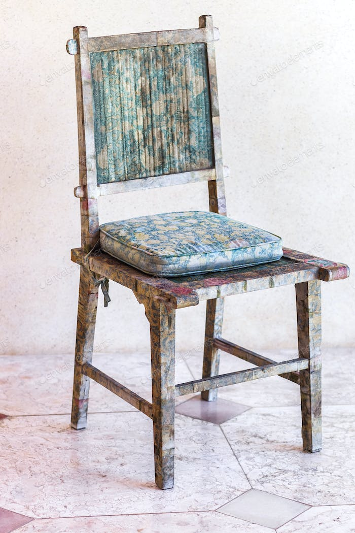 Shabby vintage handmade wooden chair. Wood carving