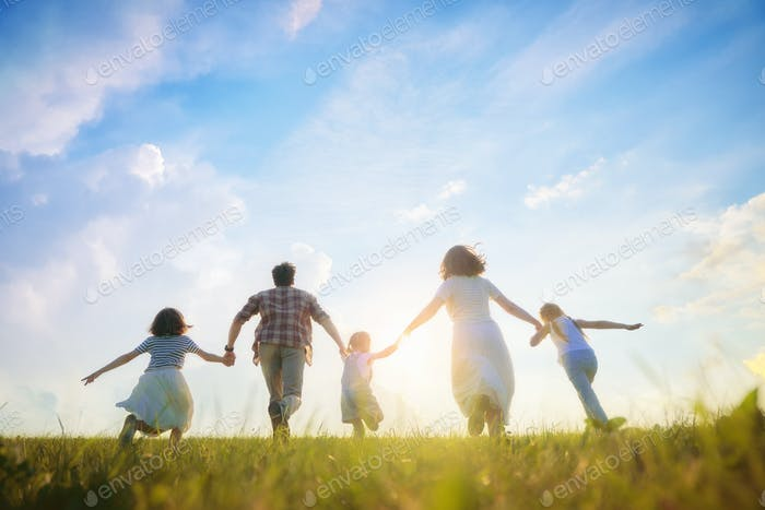 Happy family on summer walk