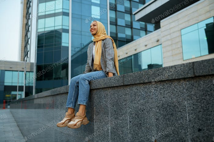 Arab girl in hijab at the building in downtown