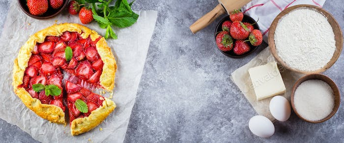 Banner for website. Summer Galette with strawberry and ingredients for cooking gaette on background