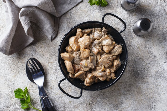 Stewed chicken fillet with mushrooms