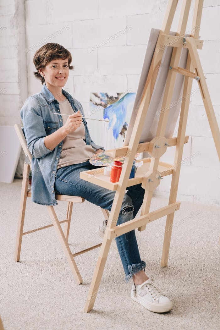 Smiling Female Artist by Easel
