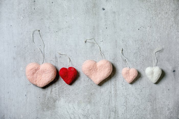 Different felted hearts